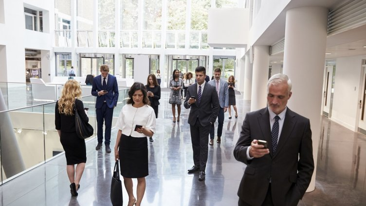 Businesspeople Using Technology In Busy Lobby Area Of Office; Shutterstock ID 479614768; Departmental Cost Code : 162800; Project Code: GBLMKT; PO Number: GBLMKT; Other:
